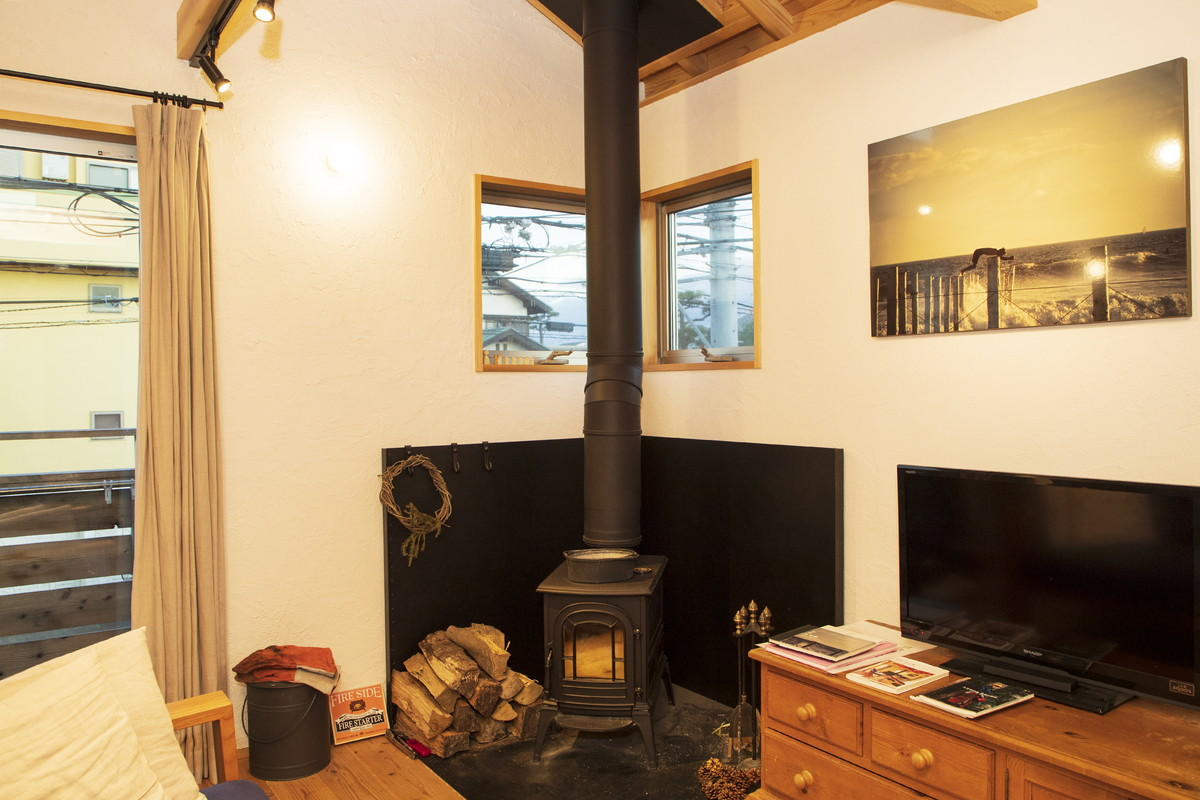 photo of his room with a wood stove
