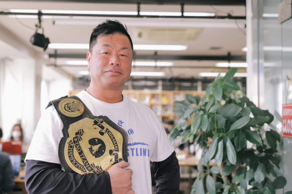 toda-san photo with the champion belt